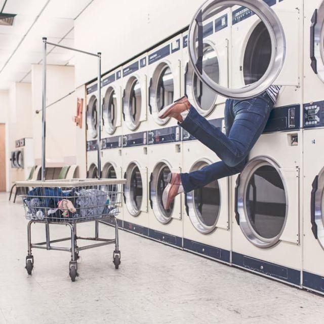 man half disappeared in washing machine